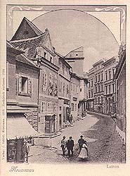 View onto lower part of Latrán Street in Český Krumlov, fountain in the foreground, historical photo