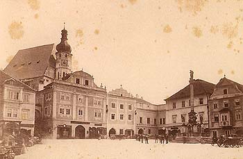 Square in Český Krumlov, in the background is Church of St. Vitus with Baroque tower from 1893 , historical photo