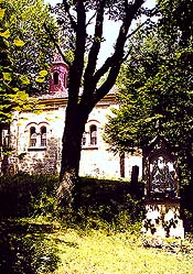 Place of pilgrimage Maria Rast near Vyšší Brod, Neoromanesque chapel of the Virgin Mary from 19th century, entrance portal, in the foreground one of the stations of the Path of the Cross, foto: Lubor Mrázek