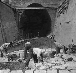 Hydro plant Lipno, waste tunnel, Paving of bottom of outlet tunnel, in back portal, year 1956, historical photo