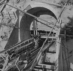 Hydro plant Lipno, sloping tunnel, concreted portal, in front cargo cart, March 1956, historical photo
