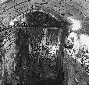 Hydro plant Lipno, Lipno I - Power plant, view into sloping tunnel at front wall with problem zone. Extraction of core is finished, On vault movable crane 5 t., at right concreted waste portal, April 1958, historical photo